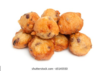 pile Dutch donut also known as oliebollen, traditional New Year's eve food isolated on white background