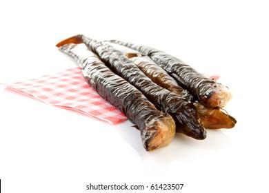pile of Dutch smoked eel on napkin isolated on white background