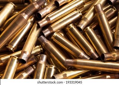 Pile of empty bullet shells . Rifle. Firearms ammunition