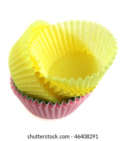 A pile of empty paper cases for cup cakes, isolated on a white background
