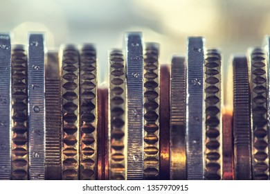 A pile of euro coins freely lying on the table. Close-up european money and currency.