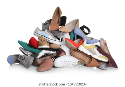 Pile of female shoes on white background