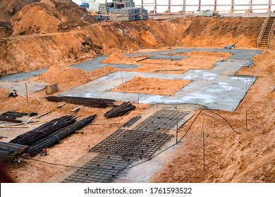 Pile field processing at mark. Panorama pit. deep foundation is type of foundation. transfers building loads to earth farther down from surface than shallow foundation. subsurface layer