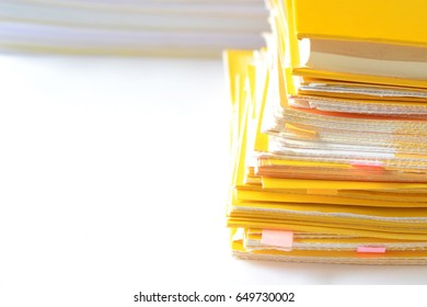 Pile of financial documents on white table with copy space for text,high key tone.