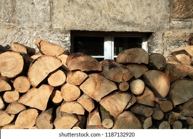 Pile of firewood. Preparation of firewood for the winter at an old farm house on the farm.