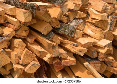 Pile of firewood. Preparation of firewood for the winter and use for cooking, firewood background, Stacks of firewood in the forest.
