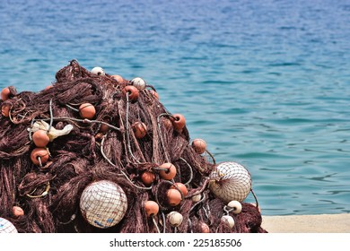 Pile of fishing nets on a pier