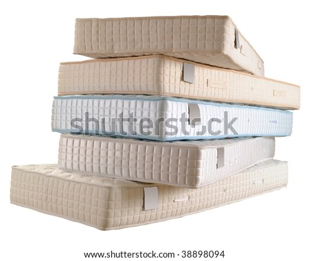 Pile of five new mattresses isolated on white