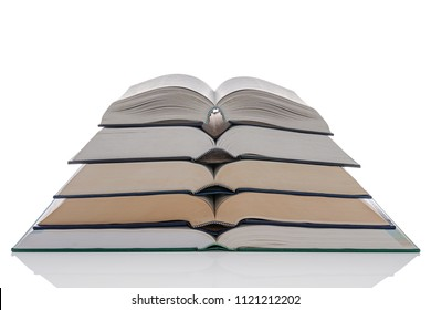 A pile of five open hardback books isolated on a white background.