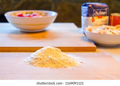 Pile of flour and other pizza ingredients