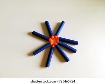 Pile of foam bullet for gun toy on plain background