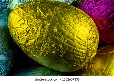 Pile of foil wrapped chocolate Easter eggs