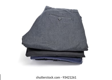 a pile of folded clothes on a white background