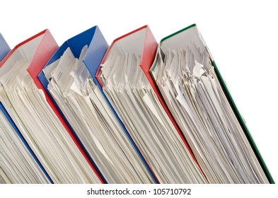 Pile of folders full of papers