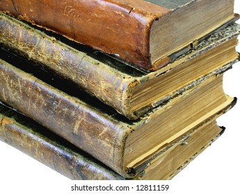 Pile from four old yellowed books on a white background.