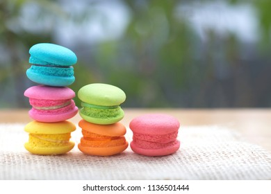 Pile of french colorful macarons on table.