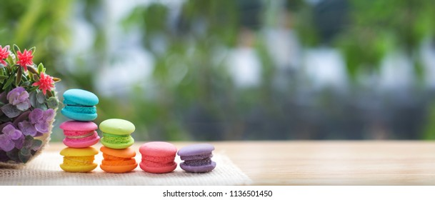Pile of french colorful macarons on table with copy space.
