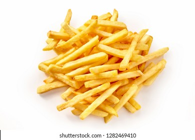 Pile of french fries potatoes viewed from above in close-up, isolated on white background