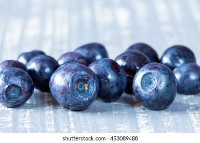 Pile of fresh blueberries on wooden surface