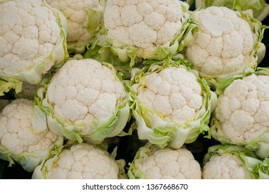 Pile of fresh cauliflower for sale at a market  -