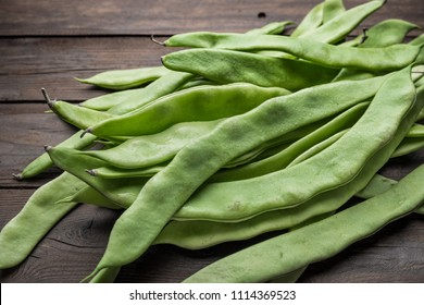 A pile of fresh green beans on table. Green runner beans. Top view