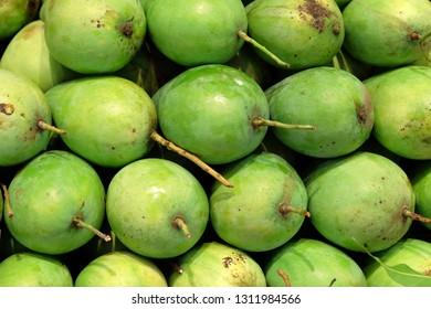 Pile of fresh green mango in supermarket.