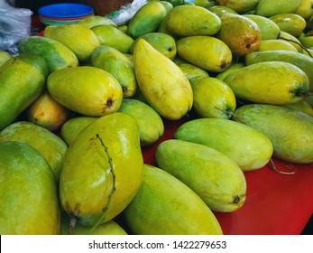Pile of Fresh Green Ripe Mangoes at Market