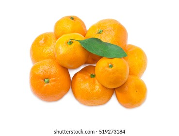 Pile of a fresh mandarin oranges with leaf on a light background