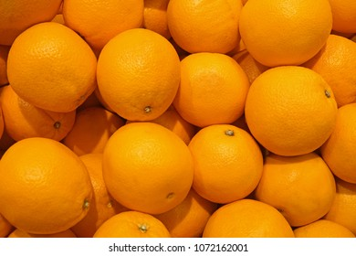 Pile of fresh navel oranges, Stack of oranges on market, Background texture