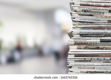 Pile of fresh newspapers on a blur background