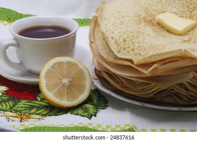 pile fresh pancake with butter and tea