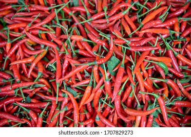 pile of fresh red chili peppers on thai market