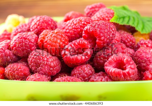 Pile of fresh, ripe raspberries, fruit background