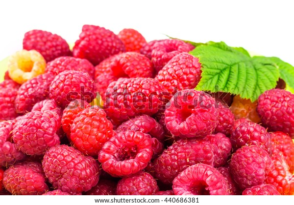 Pile of fresh, ripe raspberries isolated on white background