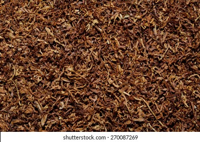 a pile of freshly cut tobacco texture in the background. closeup pattern