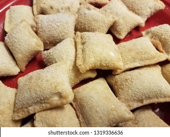 pile of frozen pizza rolls on red plate