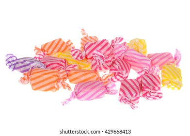 A pile of fruit chew lollies isolated on a white background