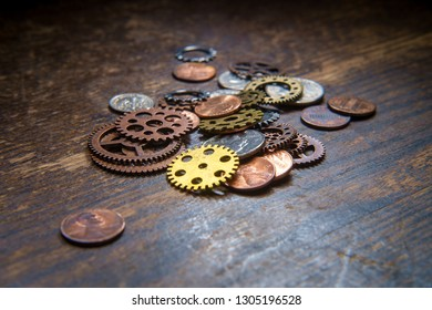 Pile of gears cogs and coins mixed together as business finance concept