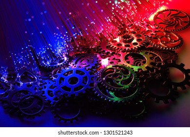 A pile of gears illuminated with fiber optics.