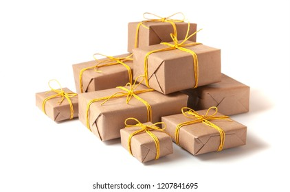 Pile Gift boxes in festive packaging with golden yellow bows isolated on white. Delivery of gifts by the postal cargo service. Concept of New Year, birthday, valentine's day, holiday