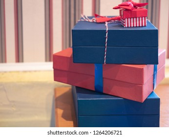 lot pile of gift presents unpacked cardboxes on a bedroom table. closeup indoor image
