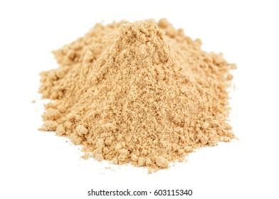 pile of ginger powder (ground) on white background