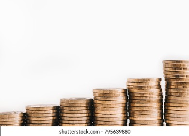 A pile of gold coins, ascending. The growth of finance. Isolated white background.