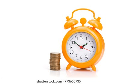 pile of gold coins and orange alarm clock isolated on white background. concept of money and time