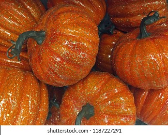 Pile of gold flaked pumpkins