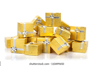 A pile of gold gifts on white background