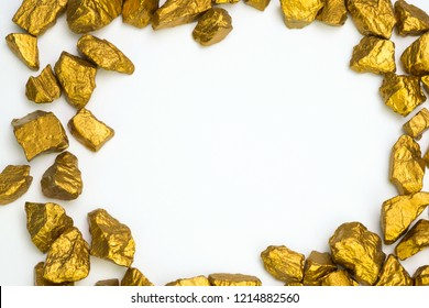 A pile of gold nuggets or gold ore on white background, precious stone or lump of golden stone, financial and business concept idea.