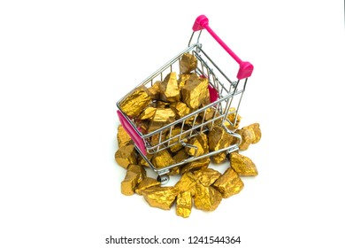 Pile of gold nuggets or gold ore in shopping cart or supermarket trolley on white  background, precious stone or lump of golden stone, financial and business concept idea.