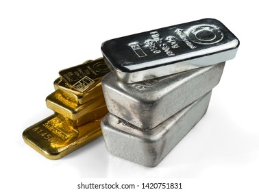 A pile of gold and silver bars. Isolated on white background.
