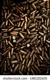 A pile of golden pistol 9mm bullets